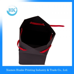 Black cross top treat tent craft flower gift paper box with red ribbon clousure